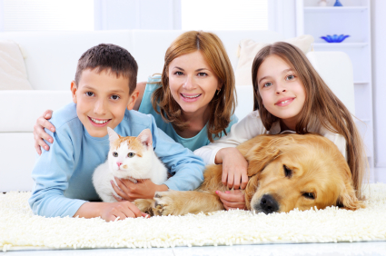 Portrait of family enjoyment-mothers with children, dog and cat.